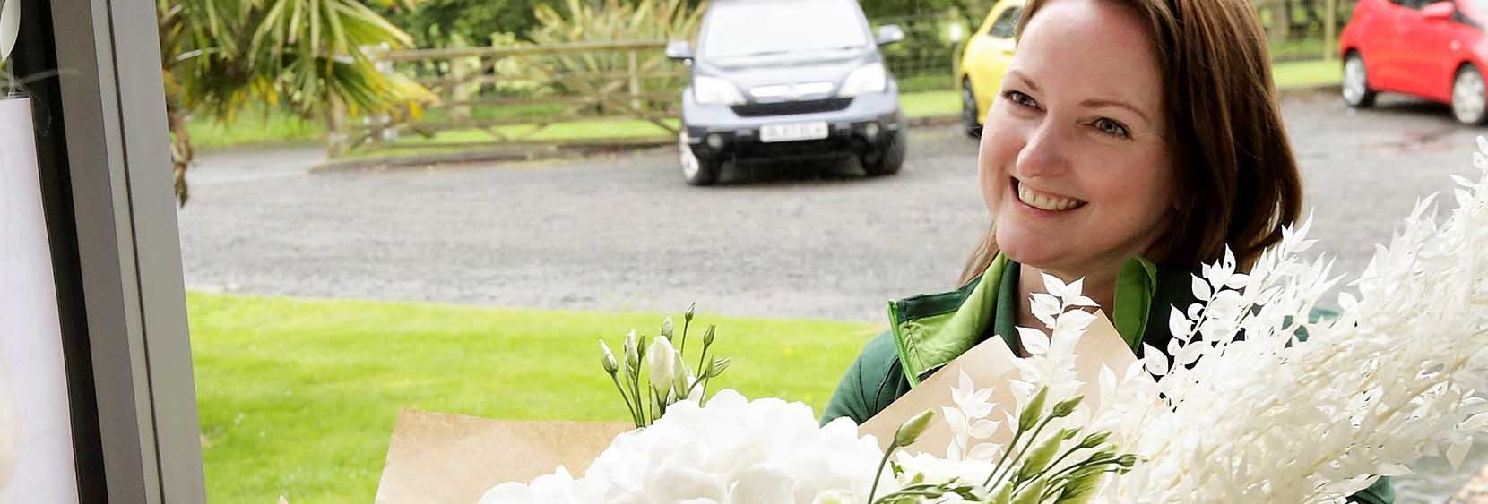 Our head florist Elaine Cherry delivering a bouquet of fresh flowers to a corporate client