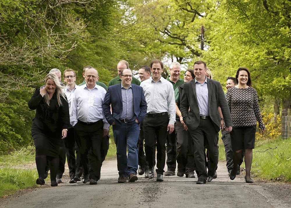 Benholm employee team walking through trees and plants
