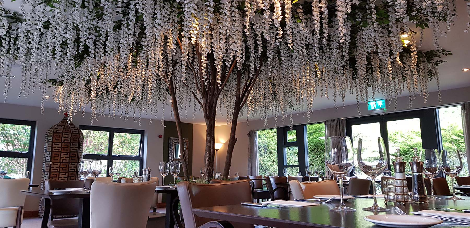 Beautiful Falkirk Restaurant with a huge bespoke artificial wisteria blossom tree creating a stunning centrepiece
