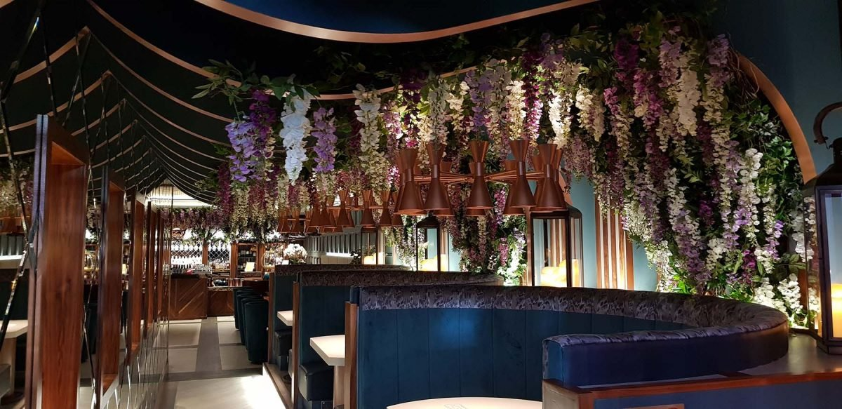 Beautiful trailing artificial foliage and festooned wisteria flowers create stunning atmosphere at Aberdeen Wine Bar