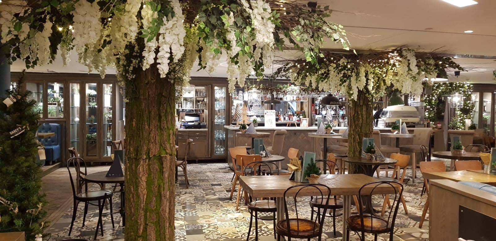 D'arcys bistro in Princess Square, Glasgow with twilight forest of bespoke artificial trees, lush greenery and thousands of twinkling fairy lights
