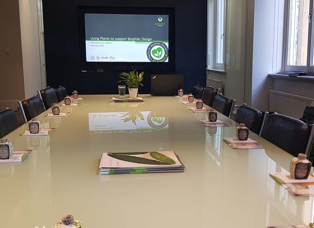 Designer conference room with large AV screen set up ready for CPD presentation on using plants for biophilic design