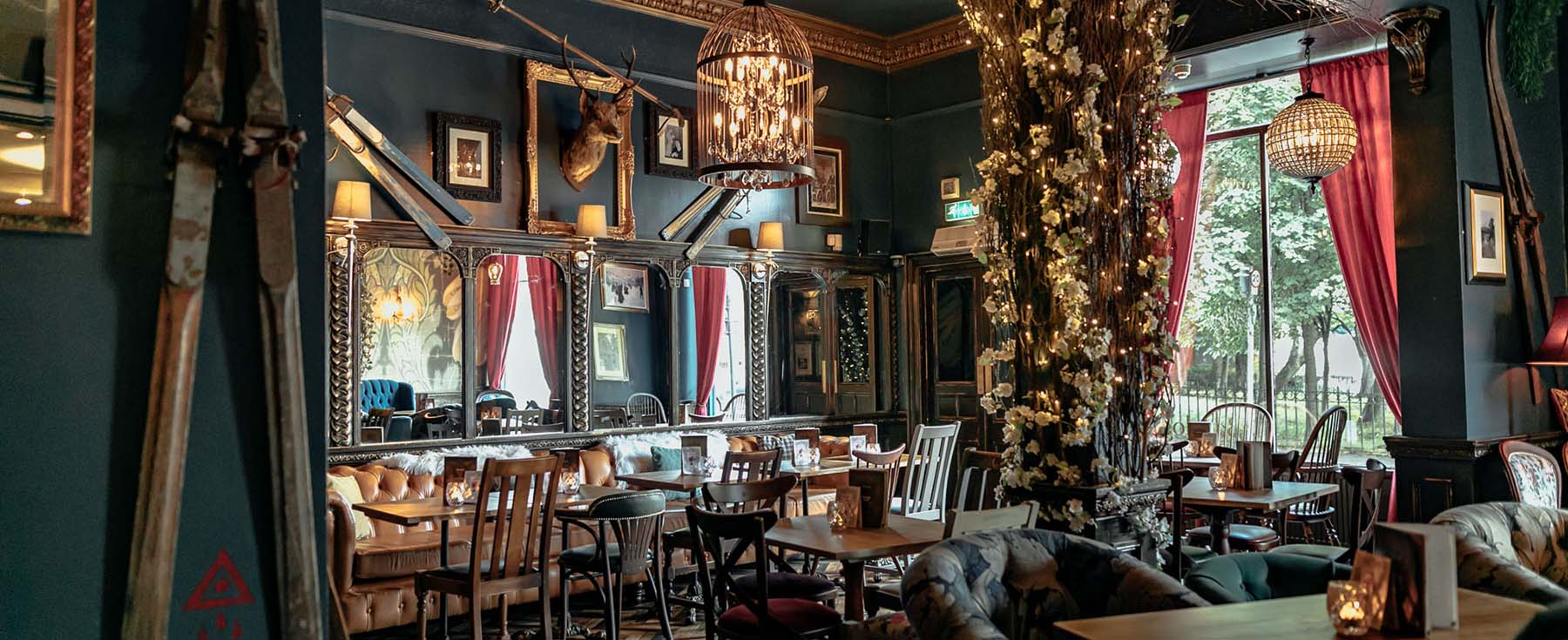 Weather-themed Barologist bar, Edinburgh with contorted willow, artificial flowers and lights create mood and atmosphere