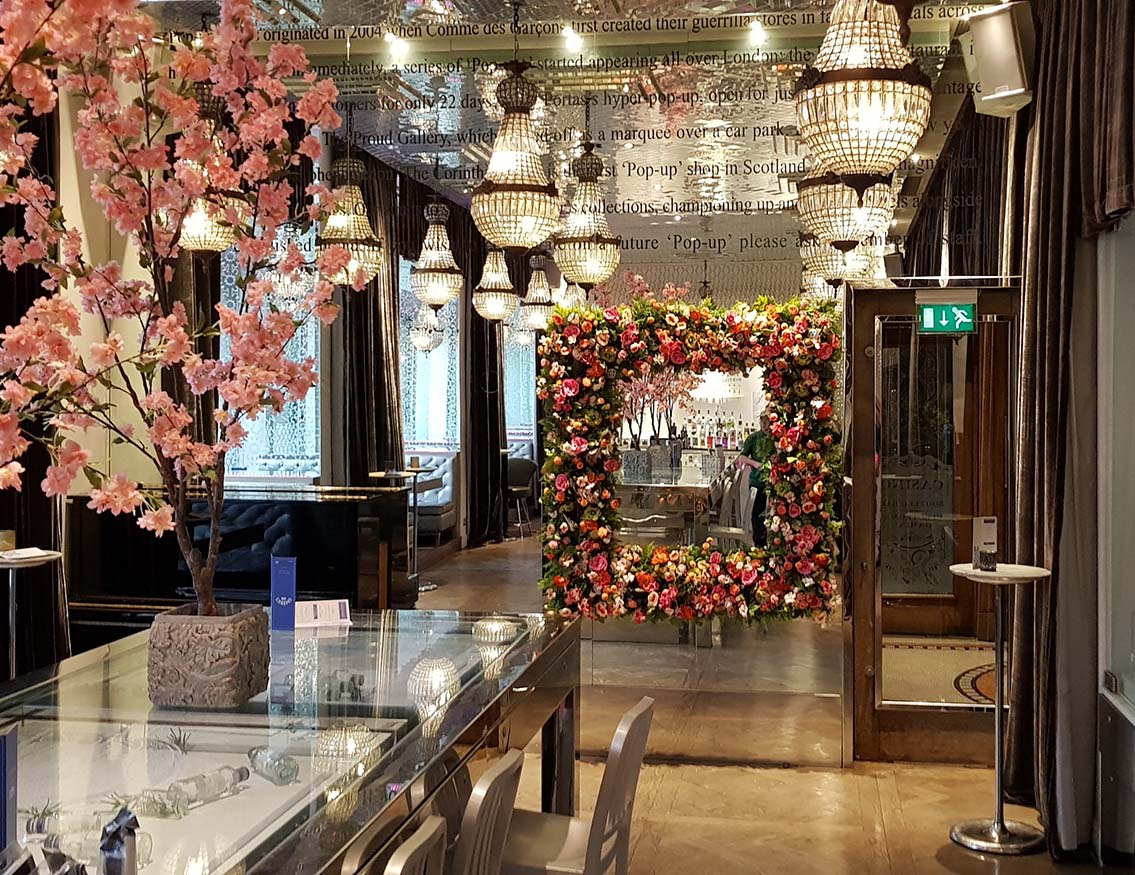 Hospitality: Champagne bar in Glasgow's luxury Corinthian Club with bespoke oversized floral frame hung on a mirrored feature wall