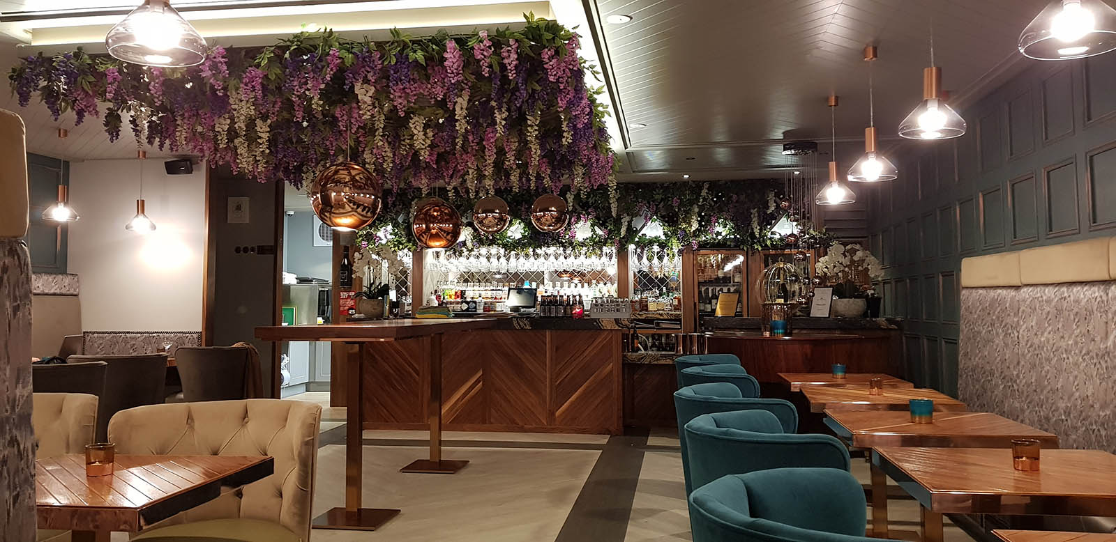 Grape and Grain Aberdeen's floral ceiling with trailing pink and purple wisteria hanging above the bar and seating area