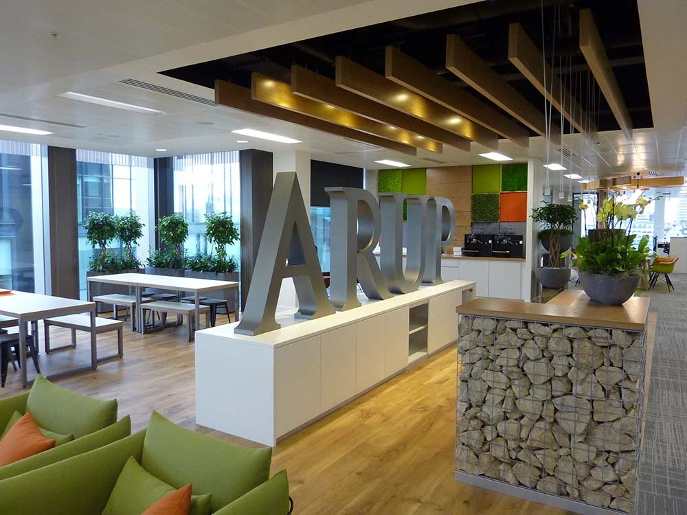 ARUP's Glasgow office planting designed to complement the interior design with leafy plants, moss, stone and concrete