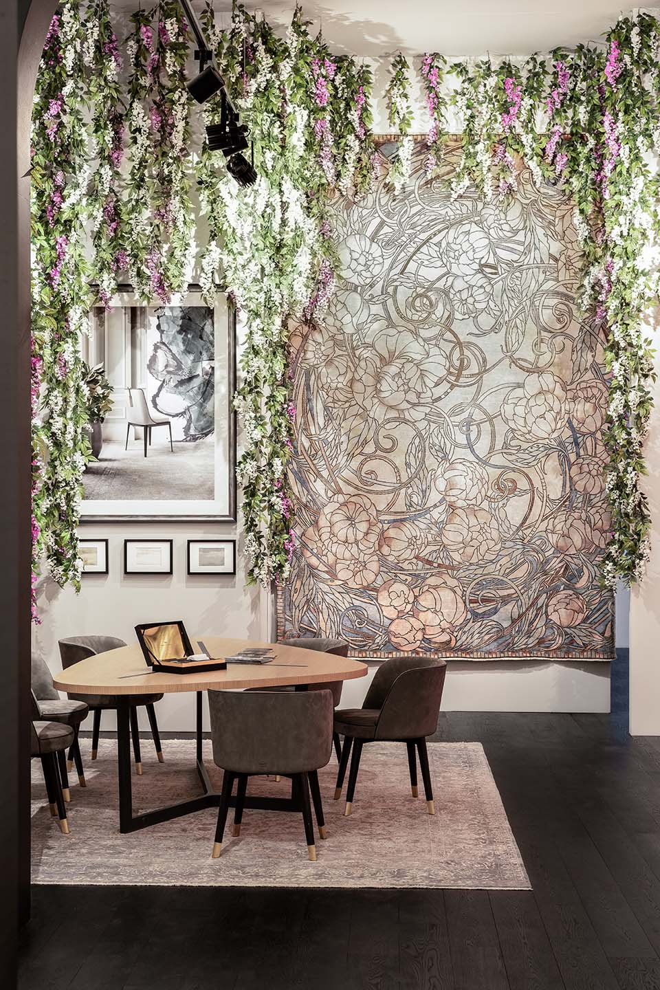 Top London designer's Milan showcase decorated with trailing artificial wisteria flowers, foliage and lush greenery
