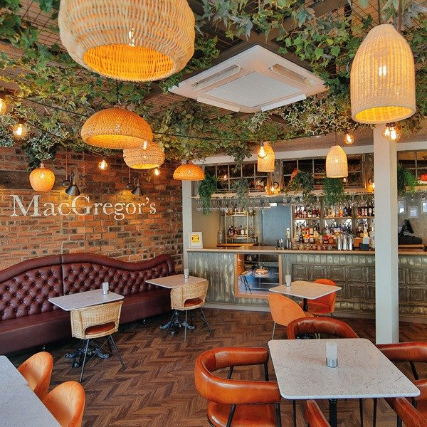 Mr MacGregors restaurant Glasgow featuring a green planted ceiling of artificial trailing foliage to complement its décor or modern, earthy tones