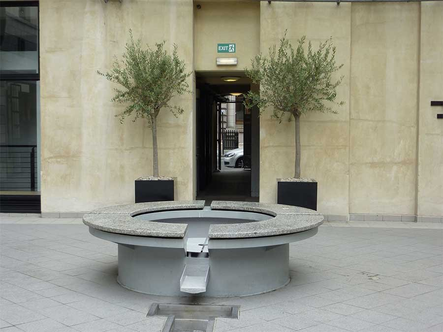 Two live olive trees in chic black matt finish cube planters at an entrance to the Italian centre, Glasgow