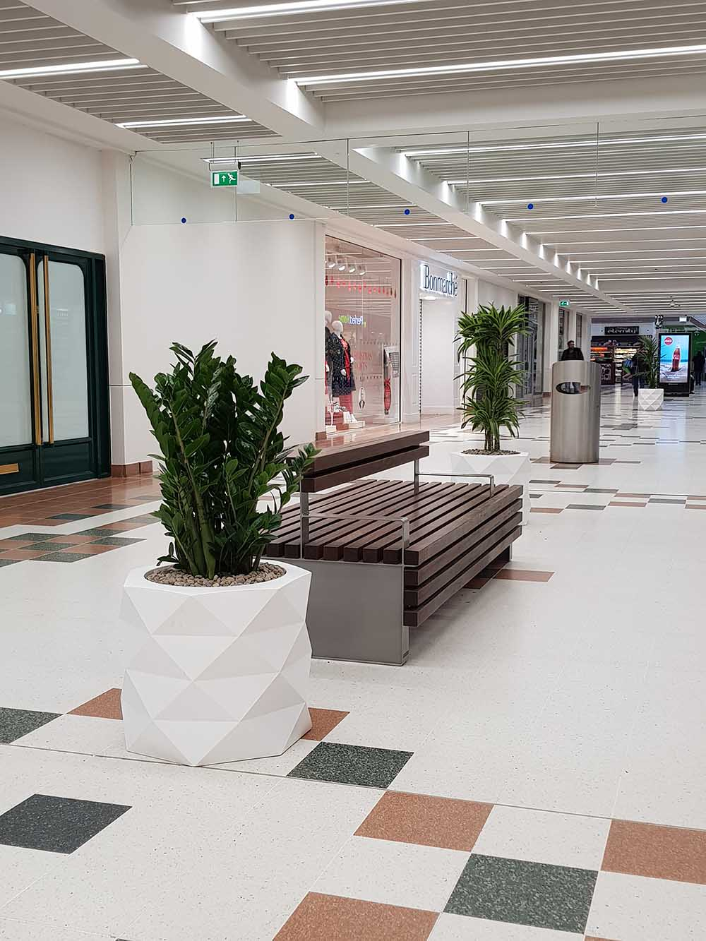 Zamioculcas zamiifolia, Draceana LemonLime and Kentia Palm in designer geometric planters bring shopping centre to life