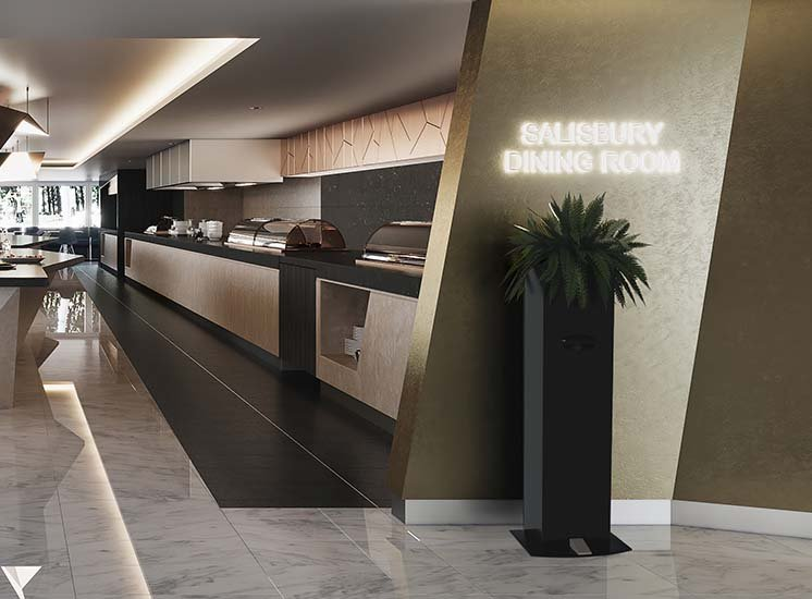 A tall touchless hand sanitiser unit at the entry of a sleek buffet dining space planted with a lush green plant